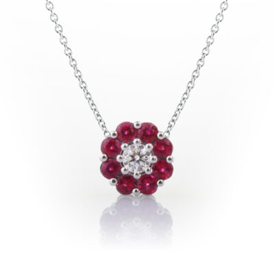 Diamond and ruby halo pendant